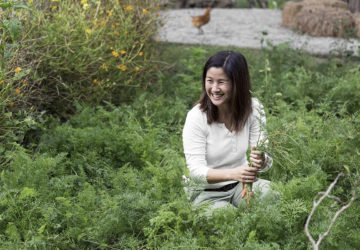 Melanie Go showcasing a portion of the vegetable patches at Holy Carabao Farm