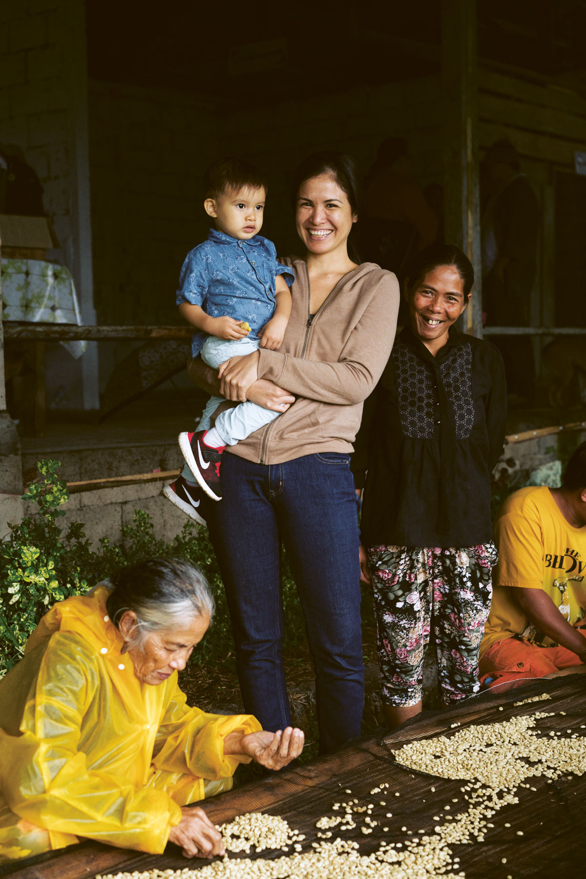 The author, Bea Misa-Crisostomo, with son Pablo and some of the coffee farming community
