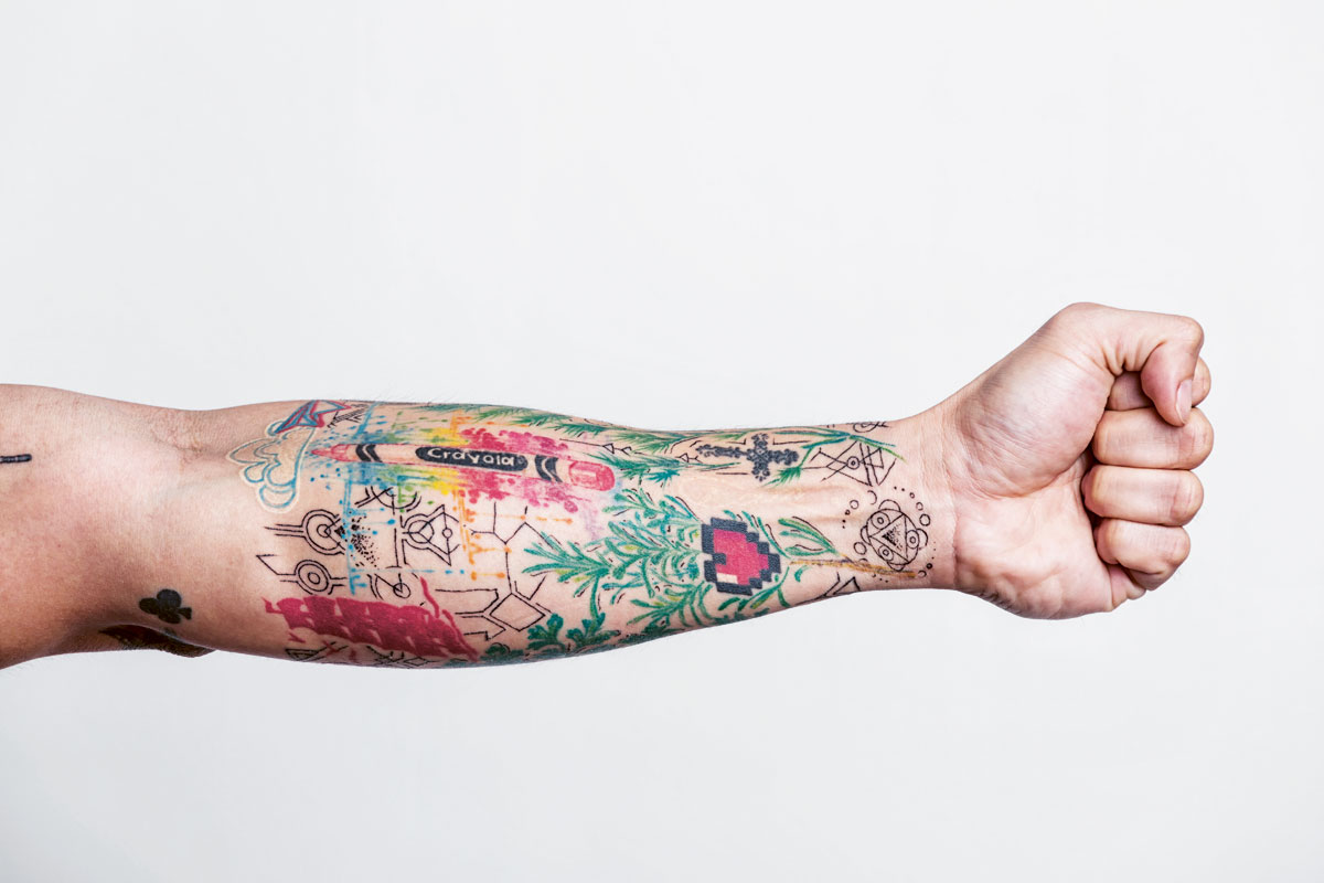 David Cruz's tattoos consist of thyme, rosemary, dill, and coriander—herbs that he's comfortable using