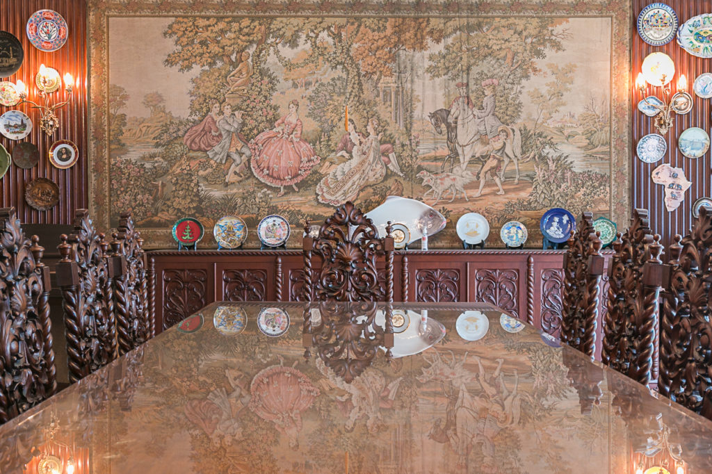 Dining area filled with elaborate designs and a collection of plates from the Juicos