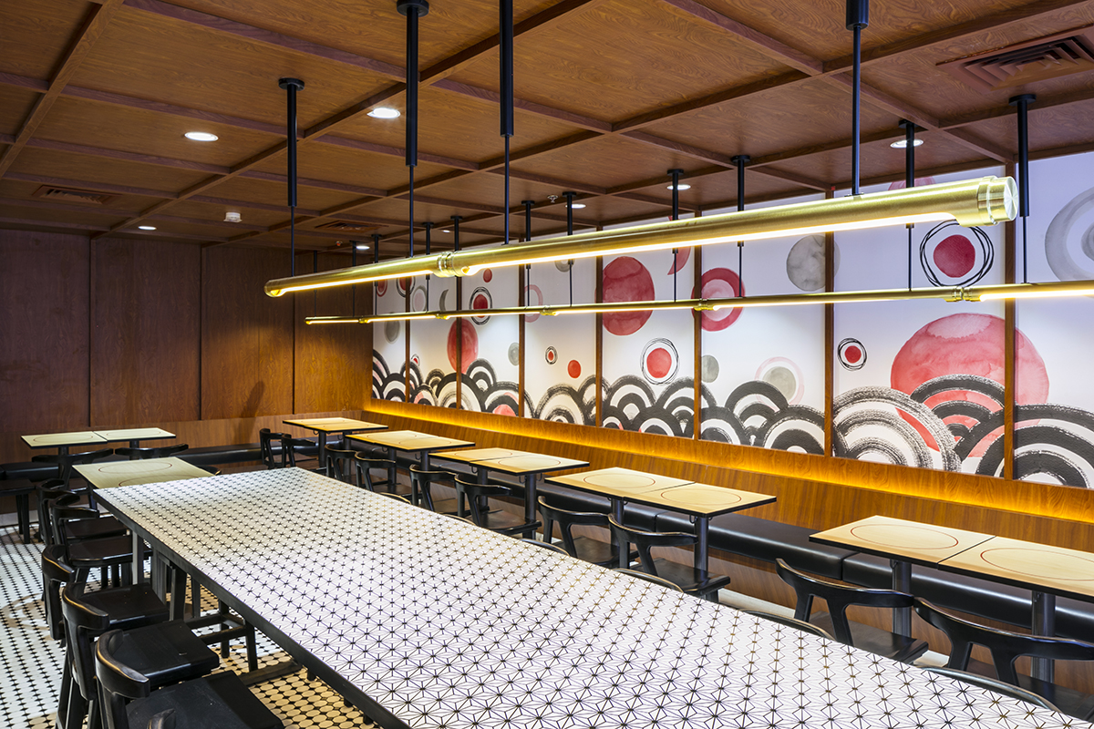 Bespoke light fixtures frame the hand-painted mural in the Tatami Room