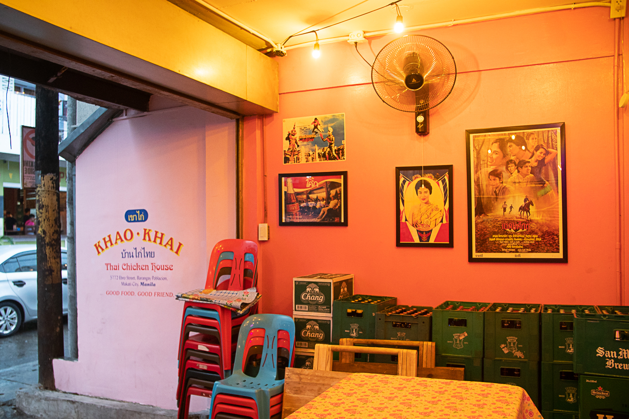 Bright pink walls are adorned with old Thai movie posters, Buddhist shrines, and photographs of the king at Khao Khai