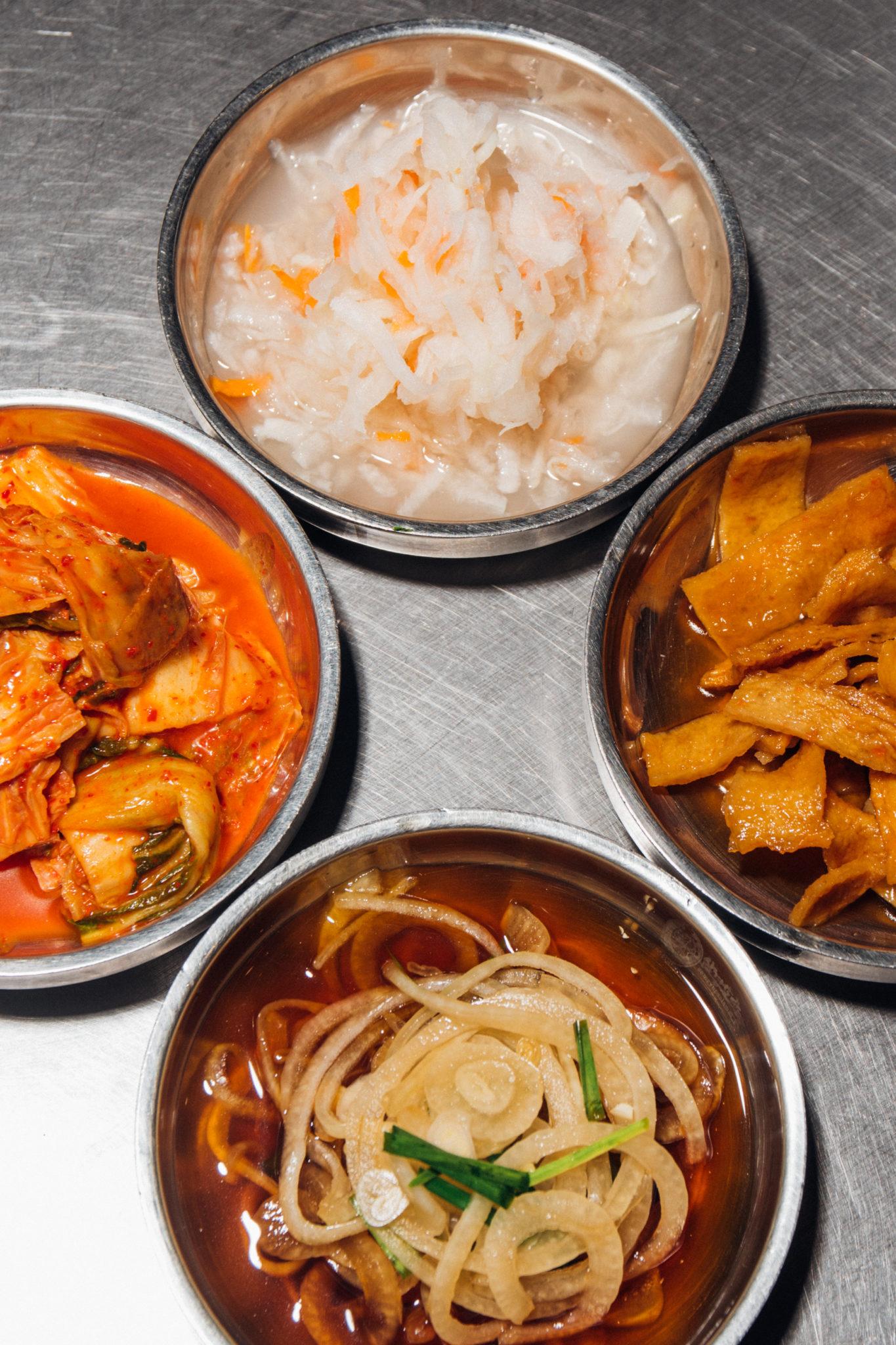 Banchan (clockwise from top): radish, tofu, onions, kimchi