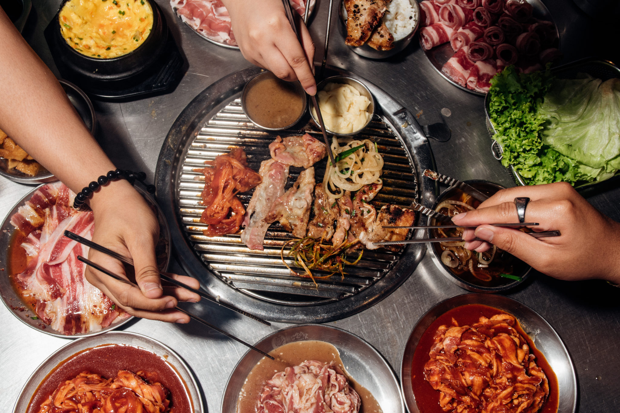 How does the business model of Unlimited Korean barbecue work?