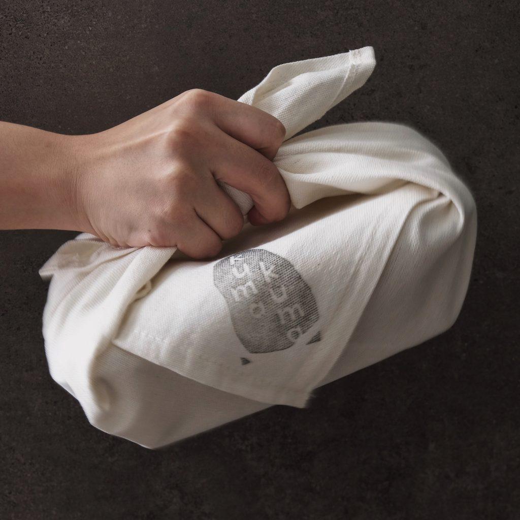 Kumakuma Curry employs the traditional Japanese custom of furoshiki-wrapping