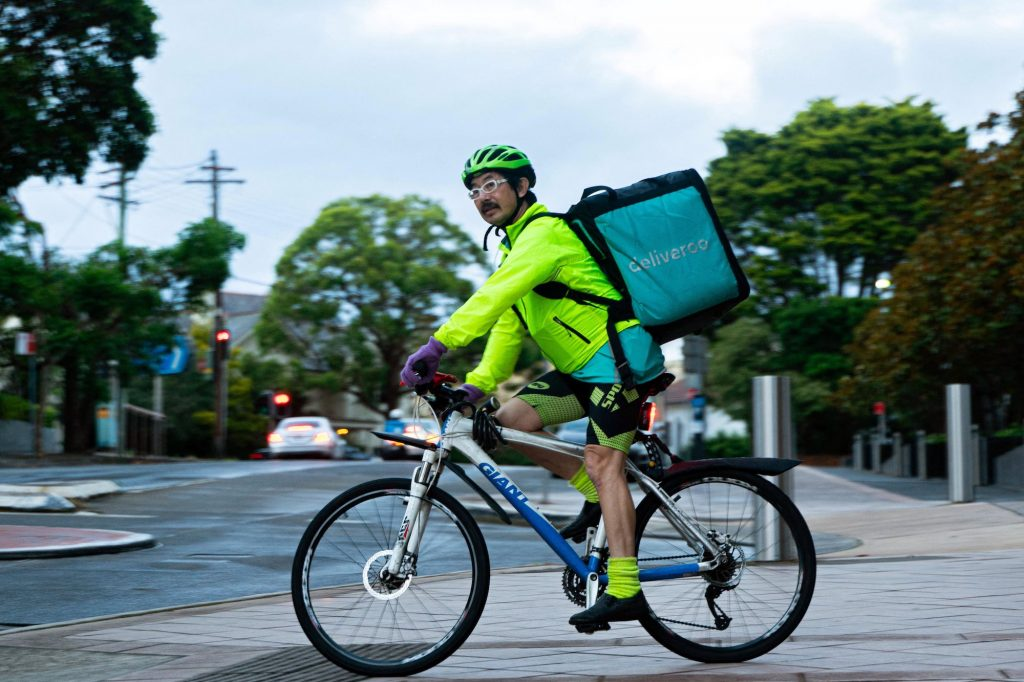Riders, who are paid by delivery, often feel pressured to rush to avoid bad reviews that can mean they are booted from a platform