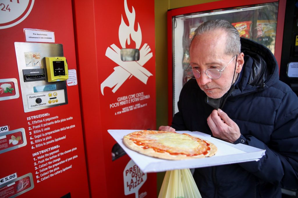 """For many Italians, the classic pizza experience includes watching a """"pizzaiolo,"""" (pizzamaker) knead the dough and cooking it in a wood-burning brick oven within sight of your table"""