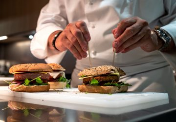 Chef Nicolas Maire prepares a vegetal burger at the headquarters of Swiss group Firmenich, one of the world's leading flavor manufacturers