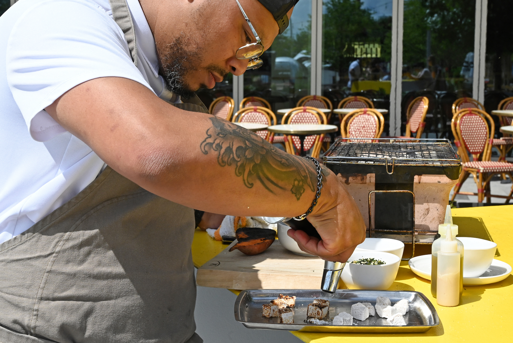 Executive chef Jerome Grant caramelizes anise spiced marshmallow before adding it to his dish of roasted sweet potato with collard furikake and sesame seed butter