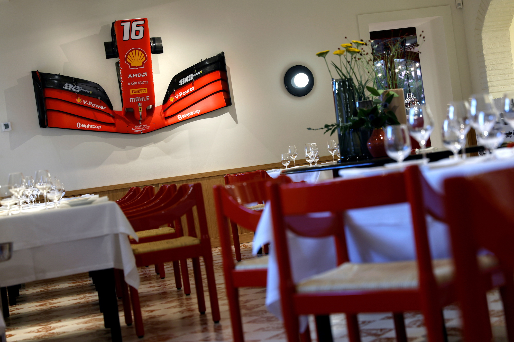 Michelin-starred cuisine next to Ferrari engines? Yes please