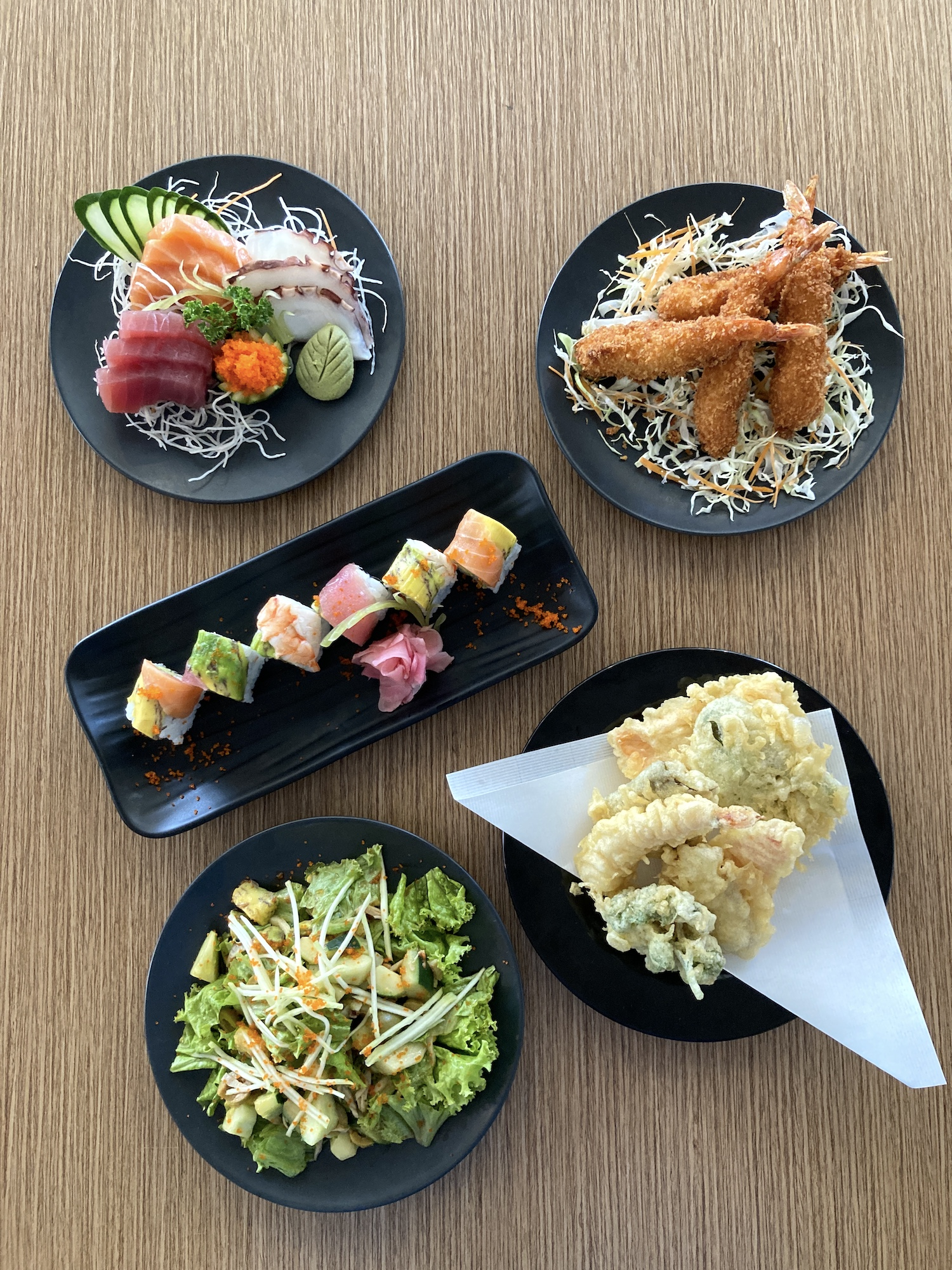 A sample of Gureisu Okawari's diverse menu—from sashimi and salads to sushi and temaki wraps