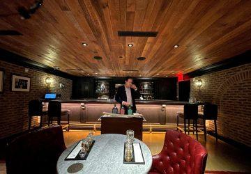 Andrew Merinoff, Great Jones Distilling Co. project manager, stands inside the distillery's speakeasy in New York