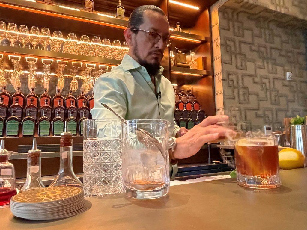 Esteban Ordonez, Great Jones Distilling Co. brand ambassador, makes a smoked Old Fashioned drink
