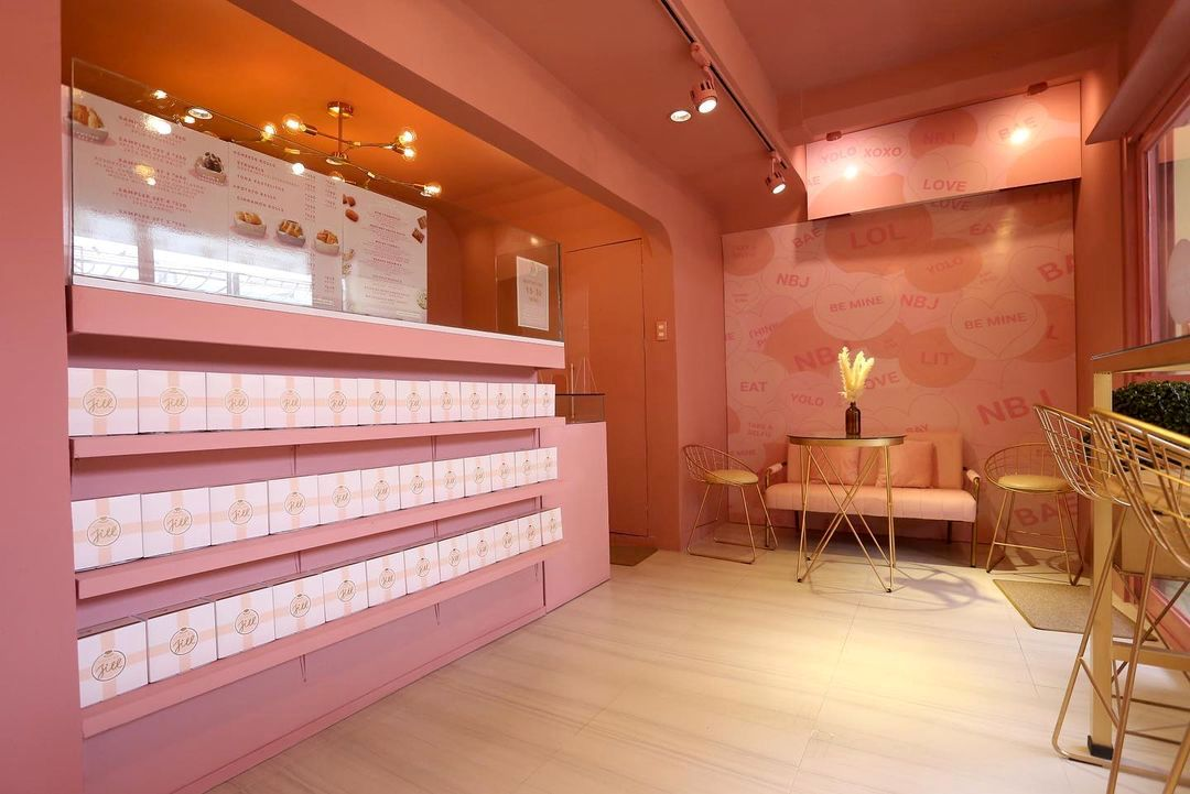 The same hues of pink and rose gold fill the space