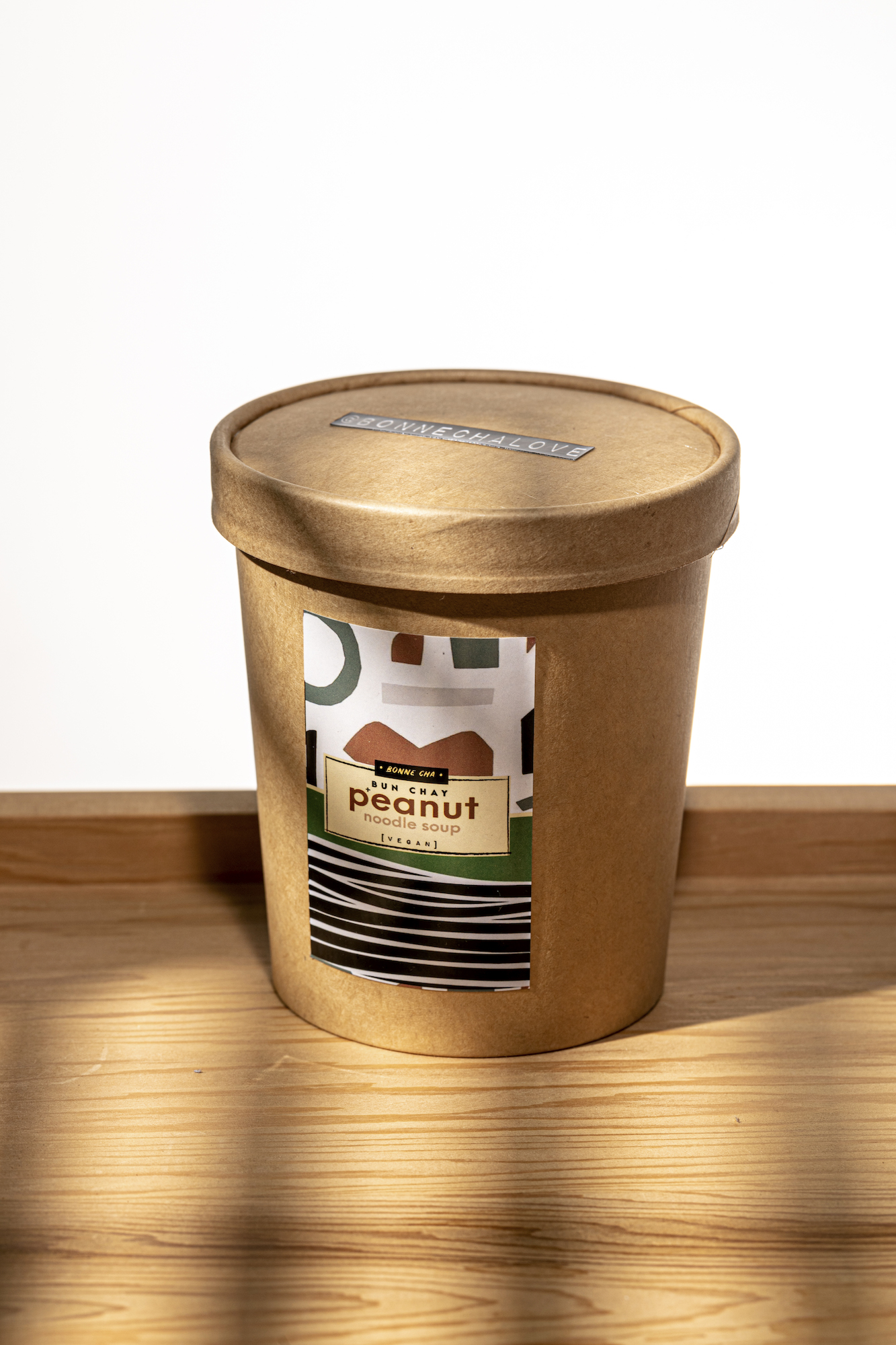 The package design for Bonne Cha's peanut sauce for its bun chay comes in a kraft cup
