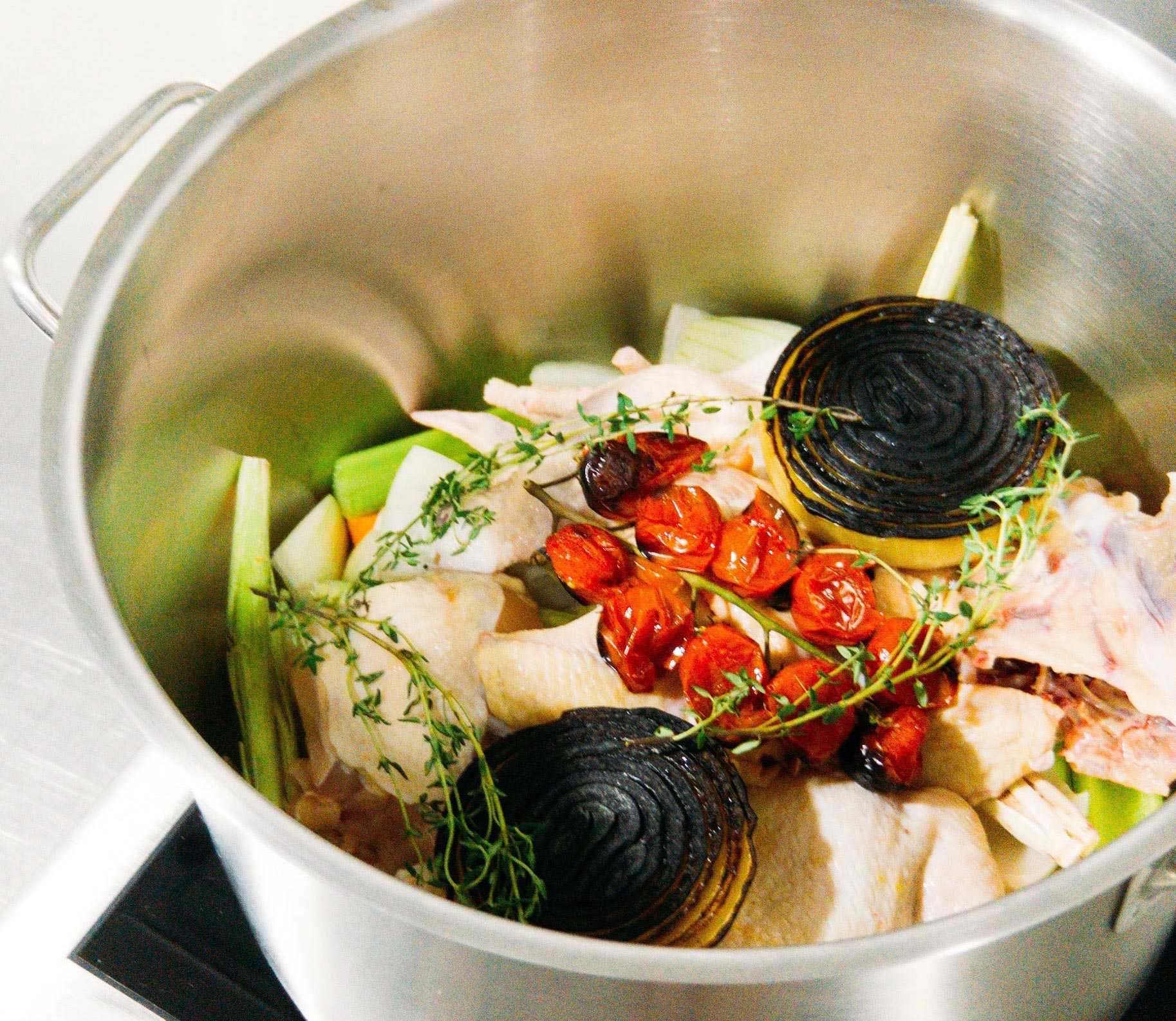 Charles Tan's tom yum chicken consommé is one of the eight dishes featured in the Lexus Culinary Perspectives cookbook